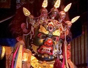 Чойджин, трехглазый защитник веры - с надутыми щеками и зверским оскалом